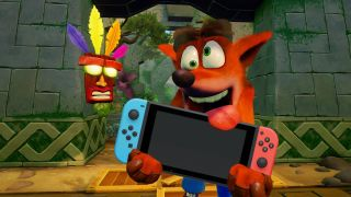 A photo illustration of Crash Bandicoot holding a Nintendo Switch.