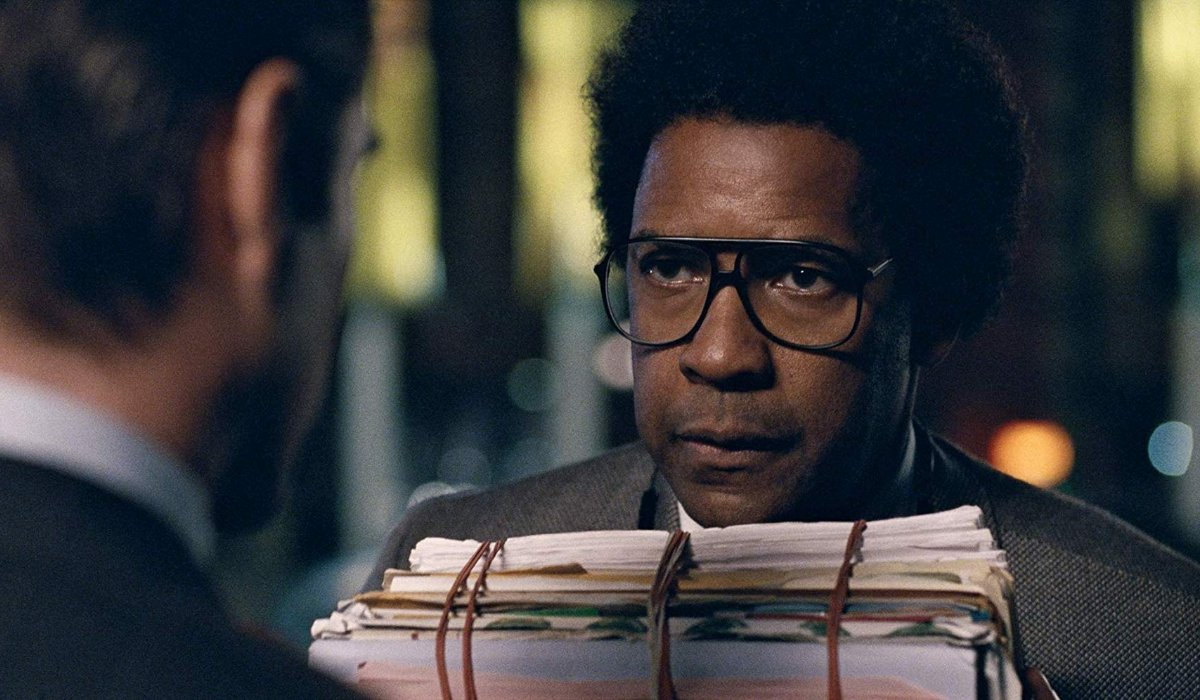 Roman J. Israel Esq. Denzel Washington stands with a bunch of rubber banded files