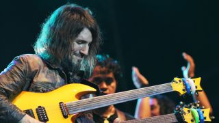 Bumblefoot is here to say your guitar - and your back