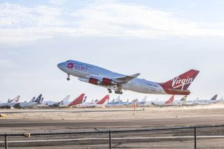 """Virgin Orbit's carrier aircraft Cosmic Girl takes off from Mojave Air and Space Port in California with the LauncherOne rocket underwing for the company's """"Tubular Bells: Part 1"""" mission on June 30, 2021."""