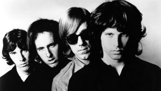 The Doors standing together, looking at the camera