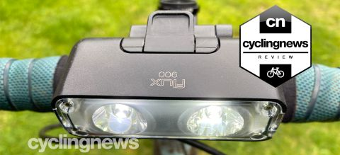 Front-on view of the Specialized Flux 900 front light, overlaid with 'review' badge