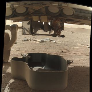 NASA's Perseverance rover has dropped the debris shield that covered the Mars helicopter Ingenuity, a step toward the little chopper's deployment and flight. This photo taken by Perseverance was tweeted out by the rover's official Twitter account on March 21, 2021.