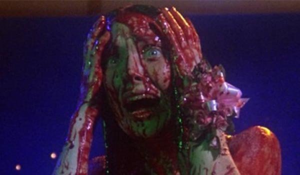 Sissy Spacek as Carrie, covered in blood at the prom