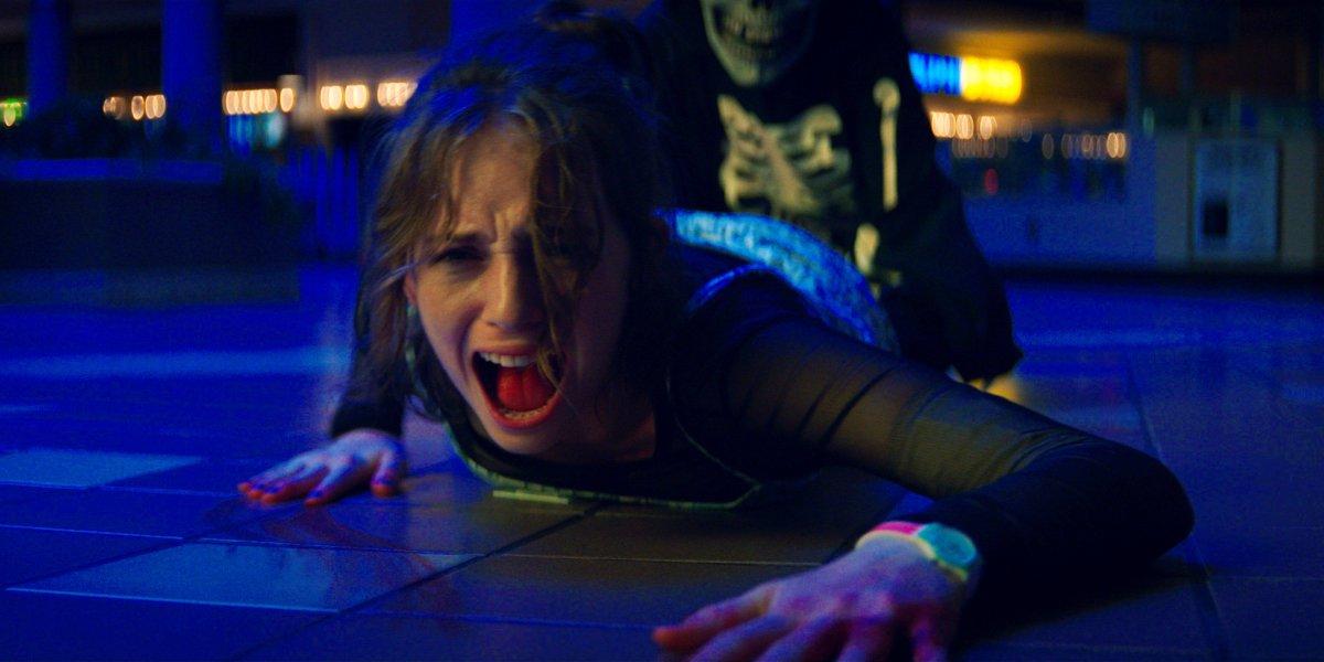 Maya Hawke screams as she's dragged by Skullmask in Fear Street Part 1 - 1994.