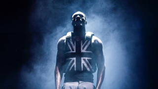 Stormzy performing in his Union Flag vest