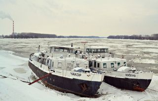 Two ships on the banks of the Danube River in Novi Sad, Serbia, on Feb. 11.