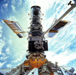 Astronauts upgrade the Hubble Space Telescope in 1999 in this NASA image. The iconic space telescope's Advanced Camera for Surveys suffered a glitch on Feb. 28, 2019.