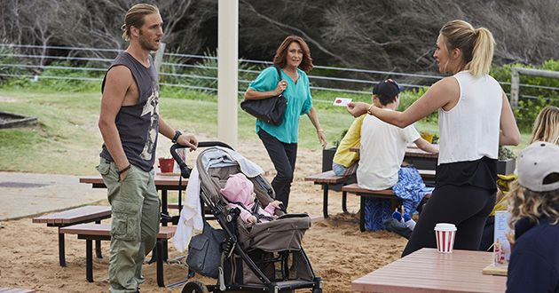 Liz hands Ash (Martin Ashford) her card with her number on it just as Irene Roberts approaches in Home and Away.