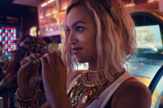 "Pop artist Beyoncé is seen in her music video for the song ""XO"", which samples audio from the Challenger disaster."