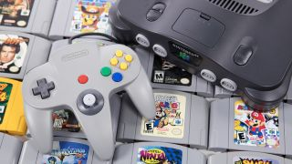 The N64 controller and console on bed of N64 games