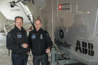 Andre Borschberg & Bertrand Piccard Pose with Solar Impulse 2 Plane