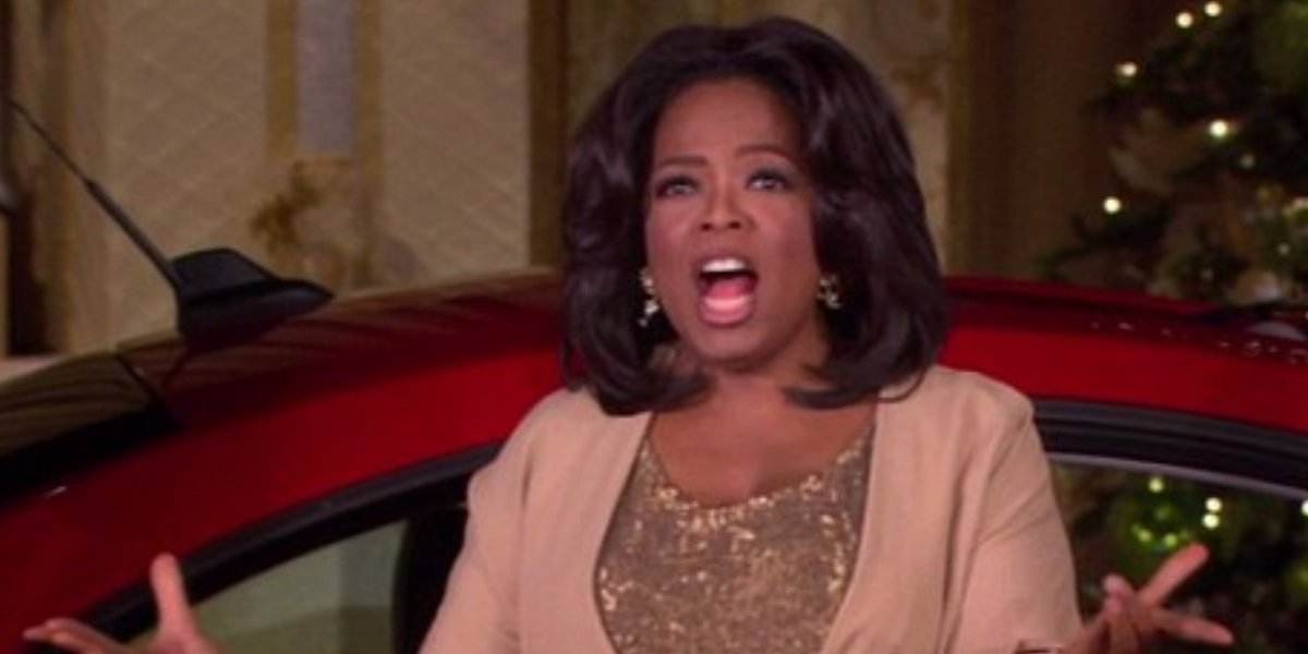 Oprah Winfrey giving out her favorite things on her talk show