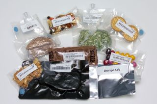 Assorted NASA space food samples including freeze-dried and thermally-stabilized dishes, drinks and desserts.
