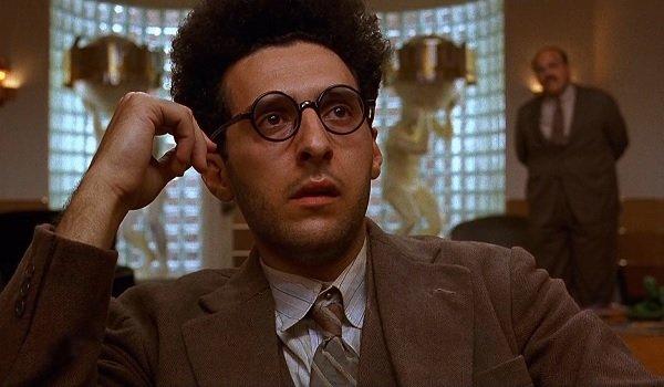 Barton Fink John Turturro listening intently