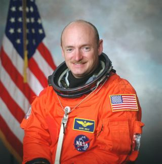 Astronaut Mark E. Kelly, commander of STS-124, poses for a preflight photo.
