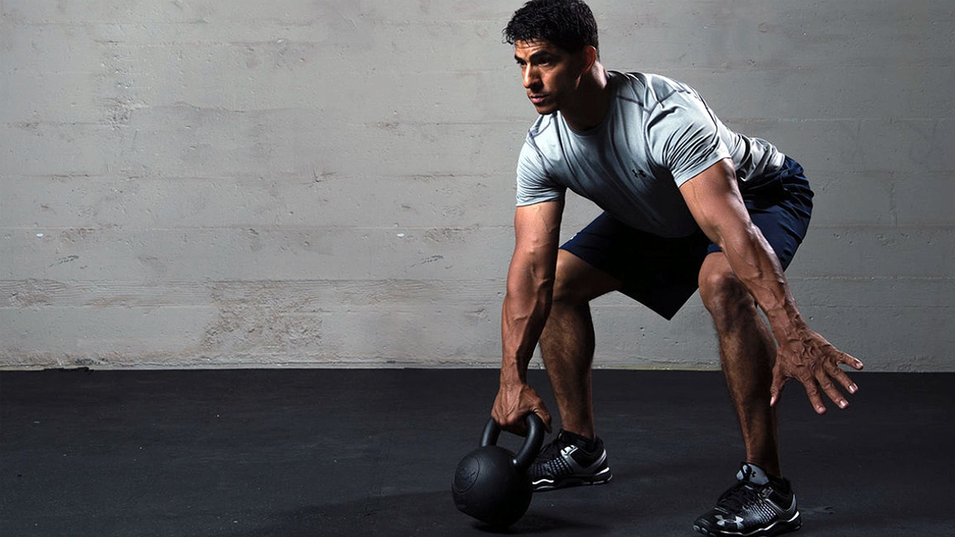 Man working out with a kettlebell