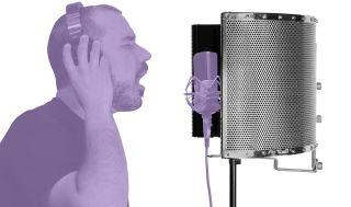 best microphone isolation shield: Man singing into microphone surrounded by isolation shield