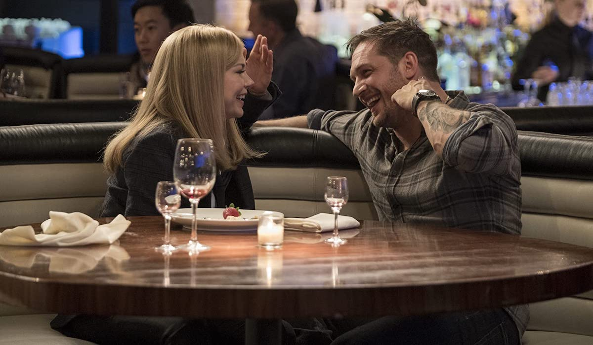 Michelle Williams and Tom Hardy as Anne Weying and Eddie Brock in Venom
