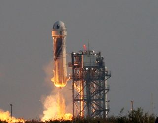 Blue Origin's New Shepard lifts-off from the launch pad carrying Jeff Bezos along with his brother Mark Bezos, 18-year-old Oliver Daemen, and 82-year-old Wally Funk on July 20, 2021 in Van Horn, Texas.