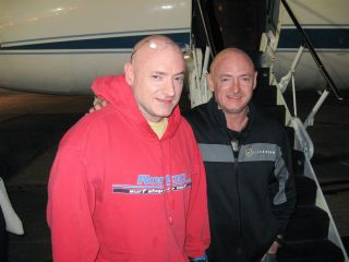 NASA astronaut Scott Kelly (left), Expedition 26 commander, is reunited with his twin brother, Mark Kelly on March 17, 2011, following a flight back to Ellington Field, Houston from Kustanay, Kazakhstan. Scott Kelly landed in Kazakhstan on March 16 with h