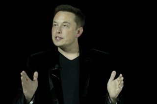 Elon Musk speaks during an event to launch the new Tesla Model X Crossover SUV on Sept. 29, 2015, in Fremont, California.