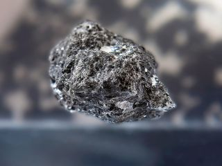 A moon rock brought back to Earth by Apollo 14.
