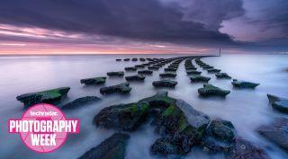 A rocky coastal seascape at dusk