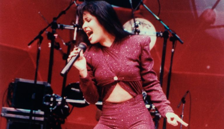 Mexican singer Selena performing in concert; one month later she would be shot and killed by Yolanda Saldivar, the pres. of her fan club, after confronting her on charges that she was embezzling funds.