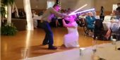 Watch This Snazzy Couple Battle With Lightsabers At Their Wedding