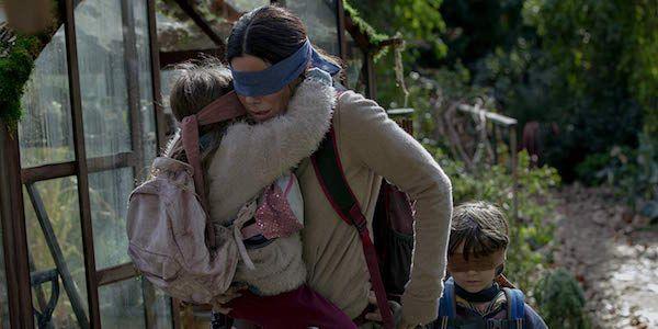 Sandra Bullock blindfolded with Children in Bird Box