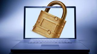 Brass padlock secures display of laptop computer