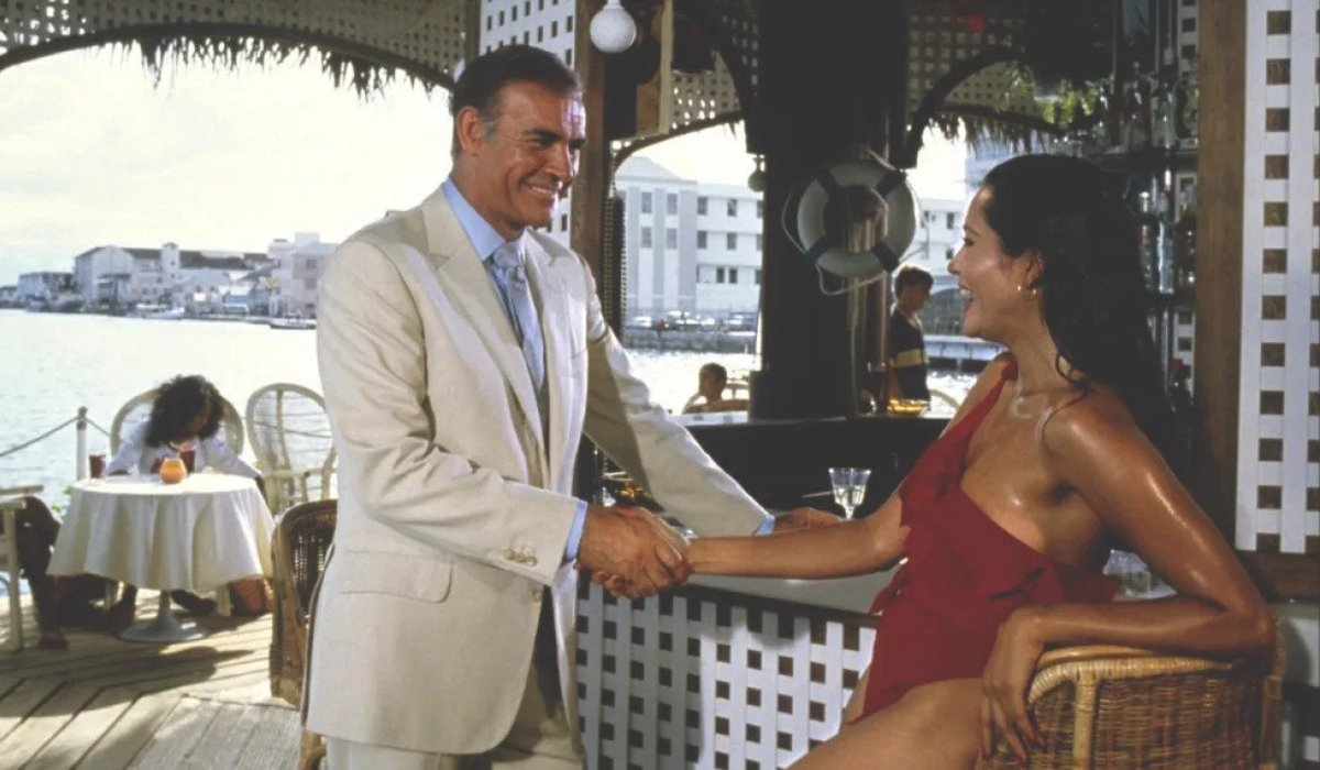 Sean Connery and Barbara Carrera shake hands in Never Say Never Again.