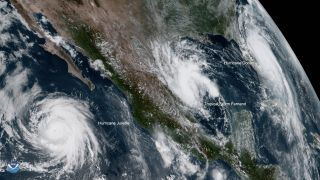 Hurricane Dorian, seen in this satellite view on Sept. 3, 2019, along with two other brewing storms.