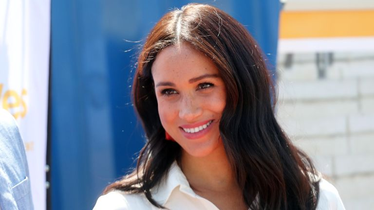 Meghan Markle, Duchess of Sussex visits a township with Prince Harry, Duke of Sussex to learn about Youth Employment Services on October 02, 2019 in Johannesburg, South Africa