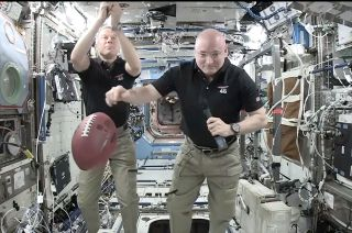 Astronaut Scott Kelly and super bowl football