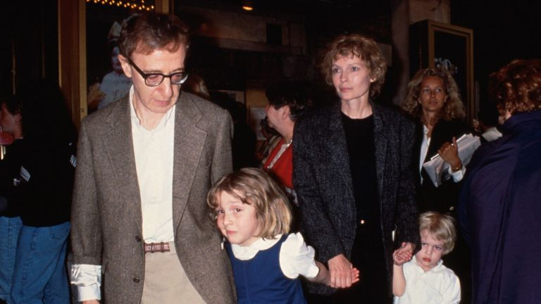 Woody Allen (L) w. Dylan Farrow (2L) and her mother, actress Mia Farrow (2R), and Allen and Farrow's son Satchel (R).
