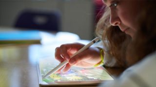 Girl using a Pencil on an iPad