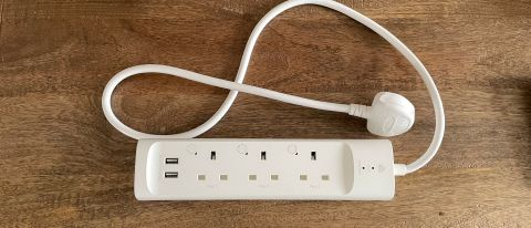 TP-Link Kasa Smart Wi-Fi Powerstrip KP303 on a wooden table