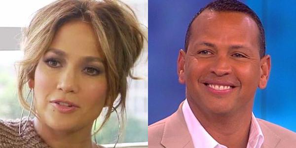 Jennifer Lopez ET interview hoop earrings updo hair