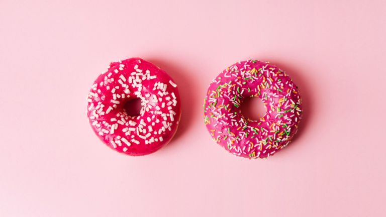 Saggy boobs: two donuts on pink background
