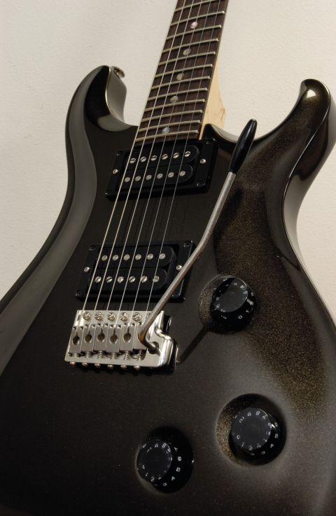 The knob behind the bridge is actually a five-way pickup selector