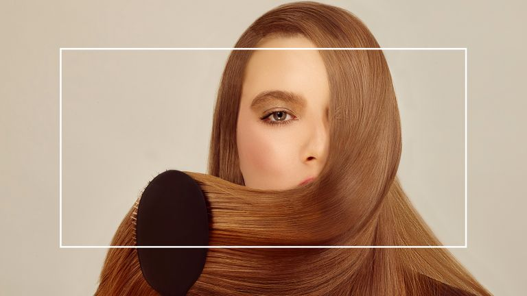 best hair dryer brushes main image of woman with a long, smooth blowout