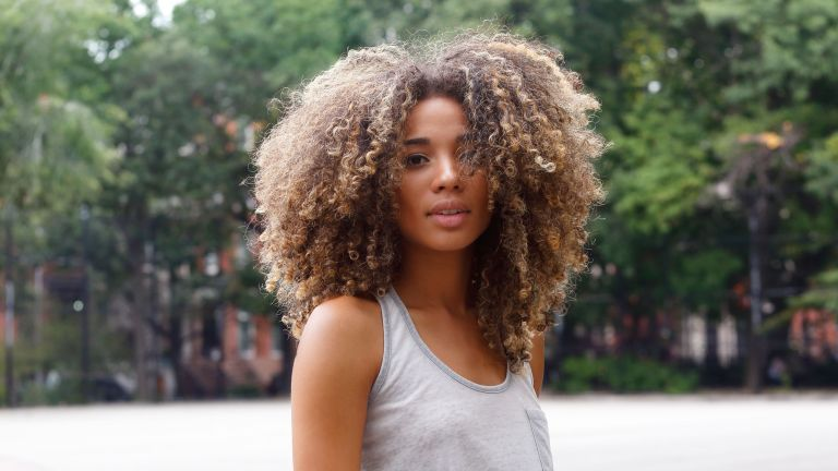Girl with curly hair looking at the camera