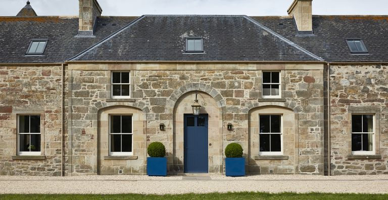 exterior of stone house with sash windows