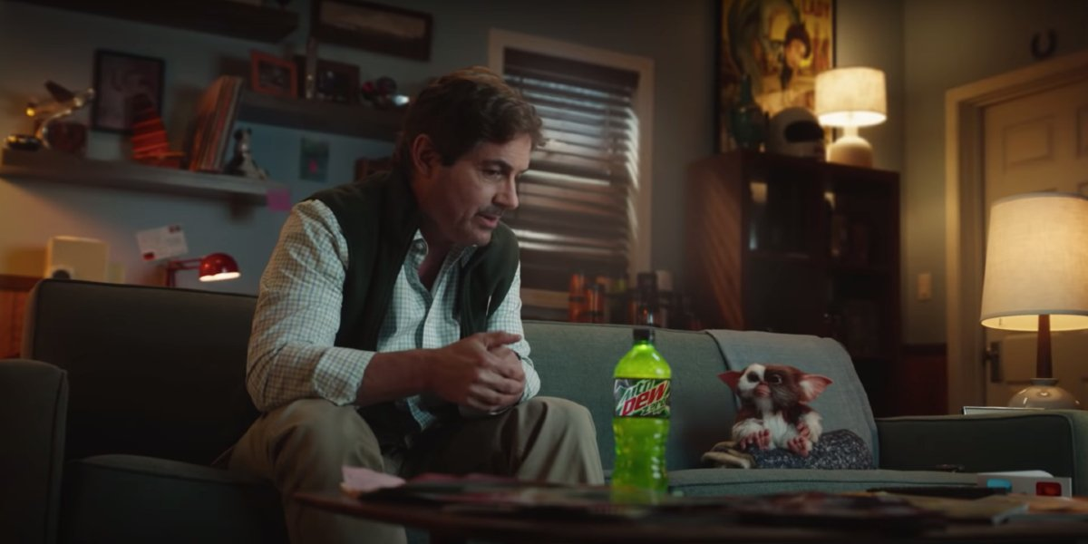 Gremlins Mountain Dew ad Zach Galligan and Gizmo sit on the couch