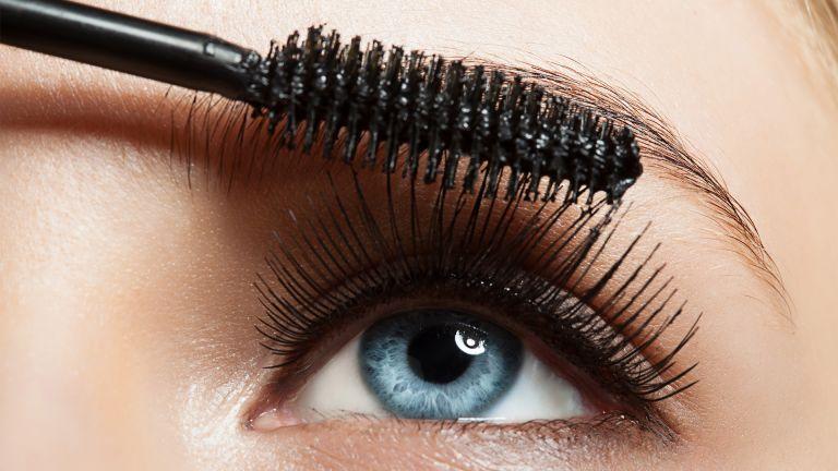 Make-up blue eye with long lashes with black mascara - stock photo