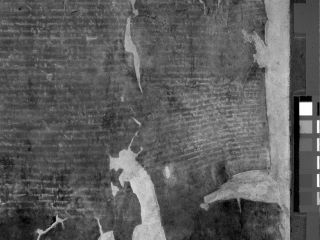 Using ultraviolet light, British Library scientists were able to photograph the text of the 1215 Burnt Magna Carta that is invisible to the human eye.