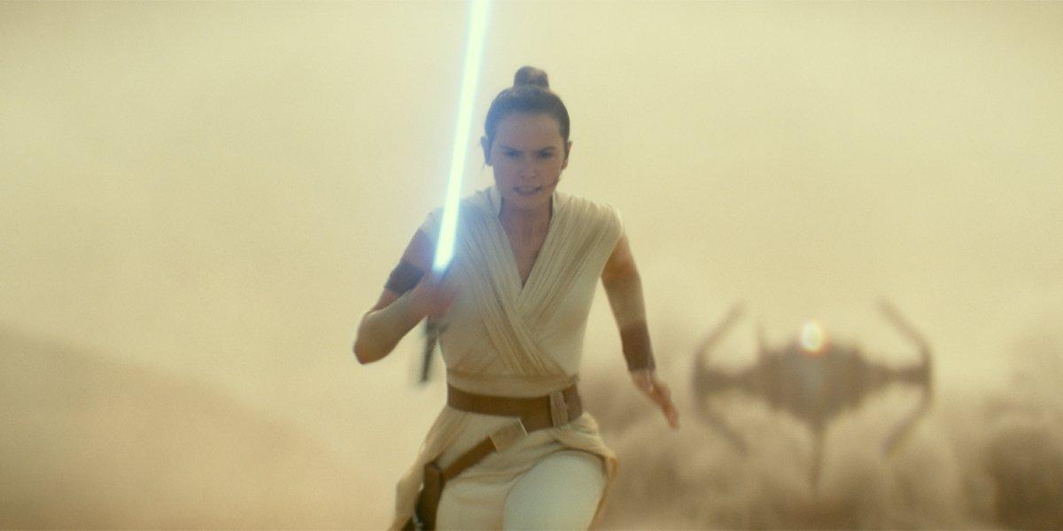 Rey running from Kylo Ren in Star Wars The Rise of Skywalker