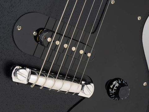The hardware is basic: a wrapover bridge and uncovered single-coil